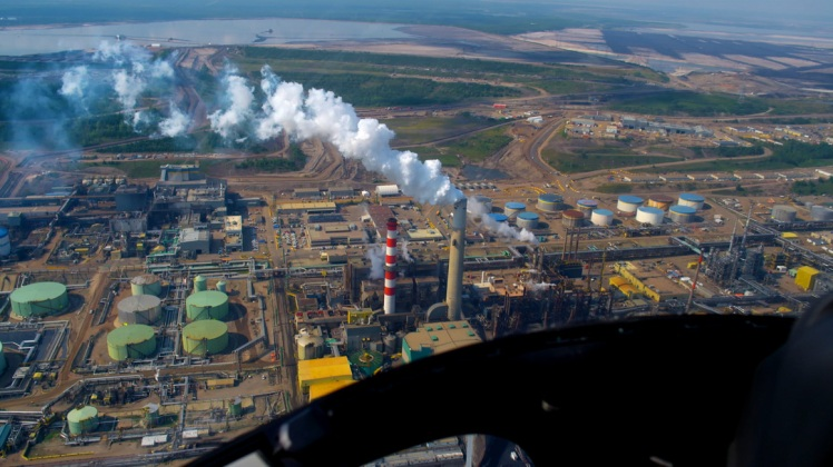 Great Canadian Oil Sands in northeastern Alberta, Canada, where Suncor Energy produces 350,000 gallons of synthetic crude oil through a process that emits greenhouse gases and wreaks havoc on local ecosystems.